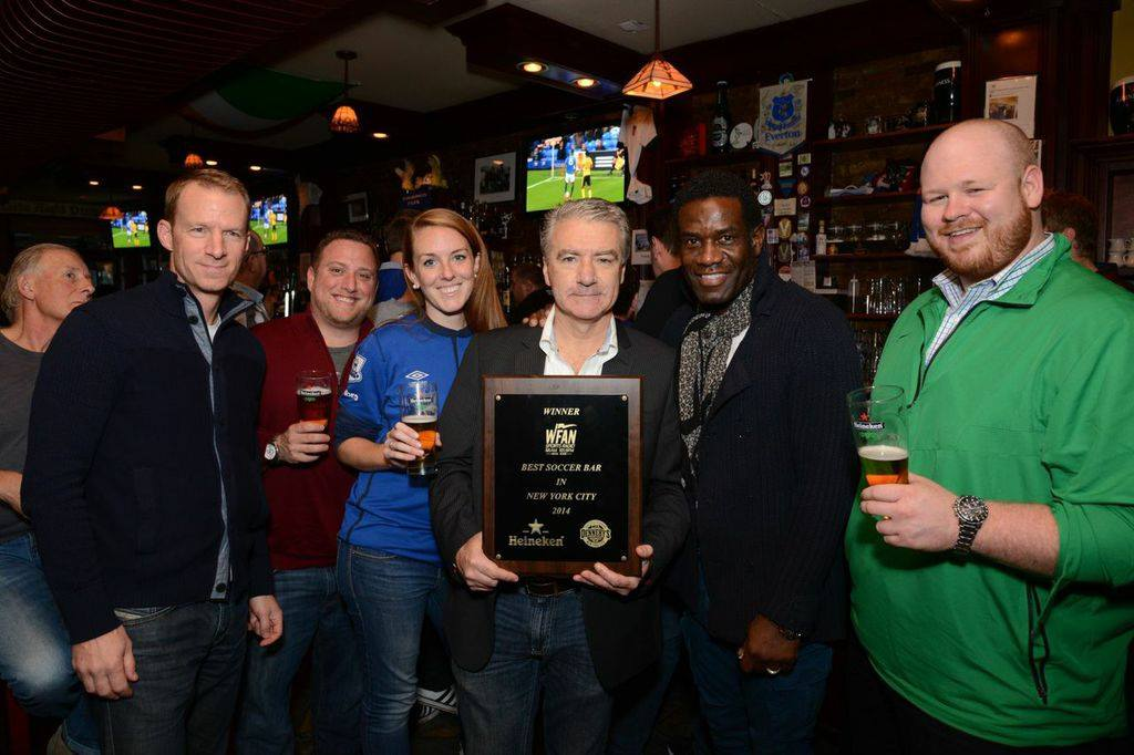 "Robbie Earle & Robbie Mustoe presenting ""Best Soccer Bar in NYC"" award."
